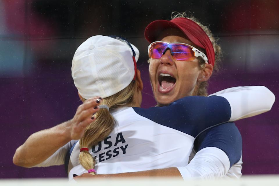 US Jennifer Kessy, left, and April Ross react during the semifinal women's beach volleyball match against Brazil at the 2012 Summer Olympics, Tuesday, Aug. 7, 2012, in London. (AP Photo/Petr David Josek)