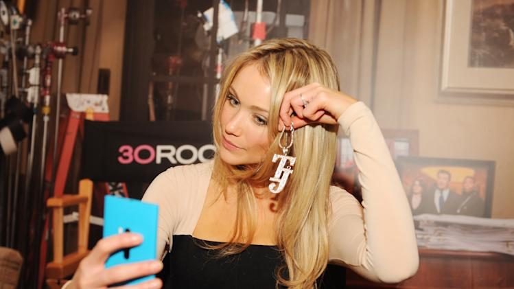 "Katrina Bowden takes her own photo in the Nokia Lumia 920 photo booth at the Nokia ""30 Rock"" wrap party on Thursday, Dec. 20, 2012 in New York. (Photo by Scott Gries for Nokia/AP Images)"