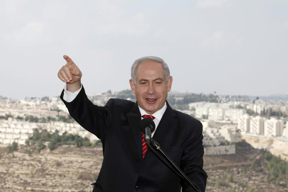 Israeli Prime Minister Benjamin Netanyahu gestures as he speaks to journalists during his visit to the east Jerusalem Jewish neighborhood of Gilo, Tuesday, Oct. 23, 2012. Netanyahu vowed on Tuesday to continue building in the Jerusalem district days after European Union criticism because it is claimed by Palestinians.(AP Photo/Gali Tibbon, Pool)