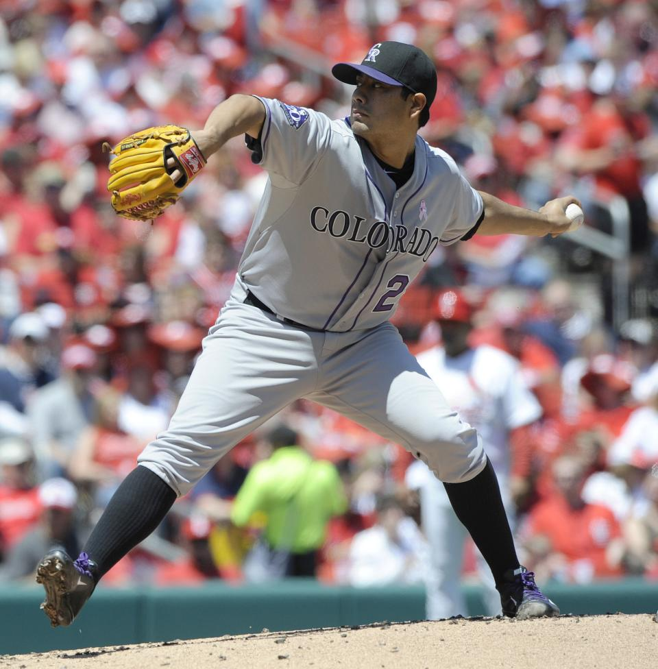 Colorado Rockies' starting pitcher Jorge De La Rosa throws against the St. Louis Cardinals in the first inning in a National League MLB baseball game Sunday, May 12, 2013, at Busch Stadium in St. Louis. (AP Photo/Bill Boyce)