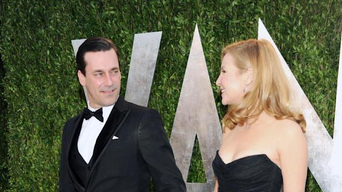 Actor Jon Hamm, left, and partner, actress Jennifer Westfeldt arrive at the 2013 Vanity Fair Oscars Viewing and After Party, Sunday, Feb. 24 2013 at the Sunset Plaza Hotel in West Hollywood, Calif. (Photo by Evan Agostini/Invision/AP)