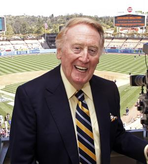 FILE - In this April 15, 2012, file photo, veteran Los Angeles Dodgers broadcaster Vin Scully poses in the press box, his first game appearance since illness forced him to miss the first home games of the season, before a baseball game against the San Diego Padres in Los Angeles. (AP Photo/Reed Saxon, File)