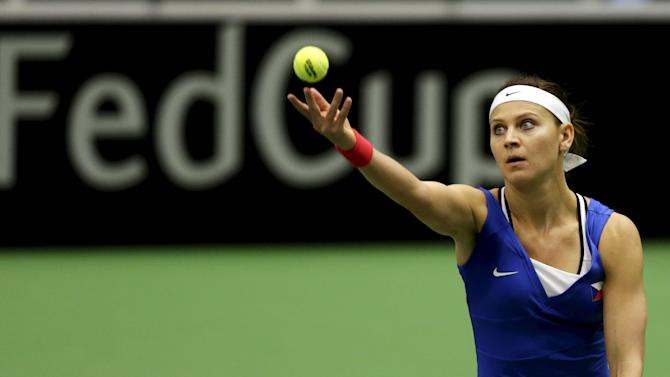 Czech Republic's Lucie Safarova serves to France's Caroline Garcia during their semifinal match of the Fed Cup tennis tournament in Ostrava