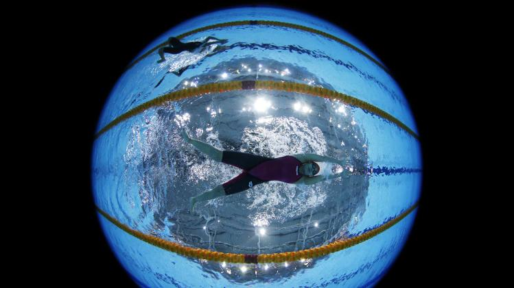 Bandey of Pakistan is seen underwater as she swims in the women's 200m Breaststroke heats during the 2014 Commonwealth Games in Glasgow
