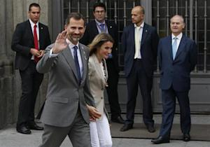 """Spain's Princess Letizia and her husband, Spain's Crown Prince Felipe, walk away after she collected money donations for the Spanish Red Cross during """"Fiesta de la Banderita"""" in Madrid"""