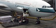 "<p>A Cathay Pacific Airbus A330 is loaded with cargo at Hong Kong International Airport. Cathay said it had studied the issue for a ""very long time"" before siding with conservationists who have long been calling for curbs on the shark fin trade.</p>"