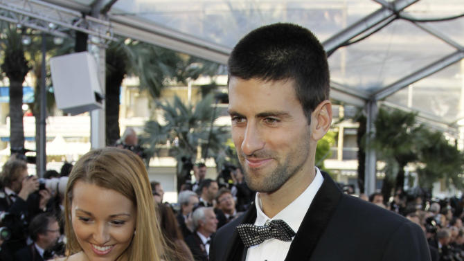 Tennis player Novak Djokovic, right, and Jelena Ristic arrive for the screening of Killing Them Softly at the 65th international film festival, in Cannes, southern France, Tuesday, May 22, 2012. (AP Photo/Francois Mori)