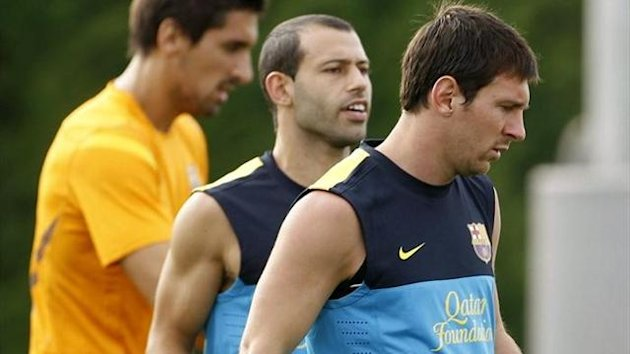 Messi y Mascherano en un entrenamiento del Barcelona