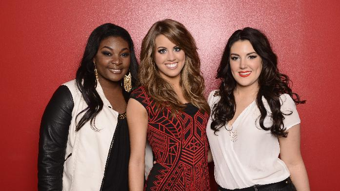 "This May 2, 2013 photo released by Fox shows, from left, Candice Glover, Angie Miller and Kree Harrison, finalists in the singing competition series ""American Idol,"" in Los Angeles. (AP Photo/Fox, Michael Becker)"