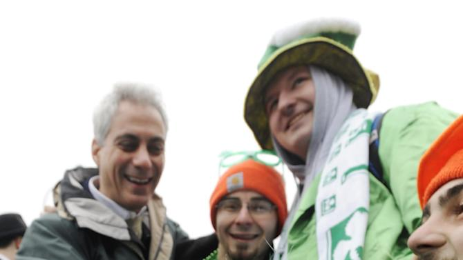 """Chicago Mayor Rahm Emanuel left, poses for a photo with """"Shamrock"""" the green dyed Irish Wolfhound and from left, Clancy Shanahan, Tony Shanahan and Cavan Shanahan before the St. Patrick's Day parade in Chicago, Saturday, March, 16, 2013. (AP Photo/Paul Beaty)"""