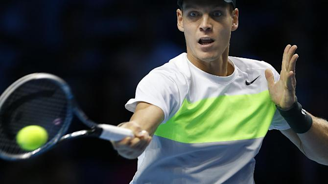 Tomas Berdych of the Czech Republic plays a return to Andy Murray of Britain, during their ATP Tennis Finals singles match, in London, Monday, Nov.  5, 2012. (AP Photo/Kirsty Wigglesworth)