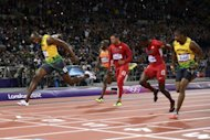 Jamaica&#39;s Usain Bolt (L) wins the men&#39;s 100m final at the athletics event during the London 2012 Olympic Games on August 5, 2012. A man screamed abuse at Bolt before throwing a plastic beer bottle on to the track just ahead of the final