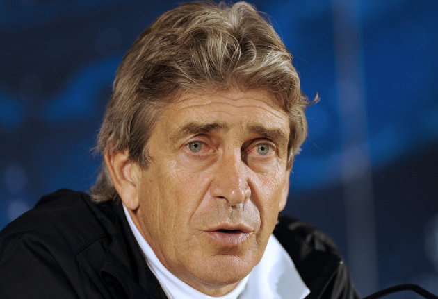 FILE - In this Feb. 18, 2013 file photo, Malaga's coach Manuel Pellegrini, from Chile, attends a news conference before a soccer training session at FC Porto's Dragao stadium in Porto, Portugal. Manch