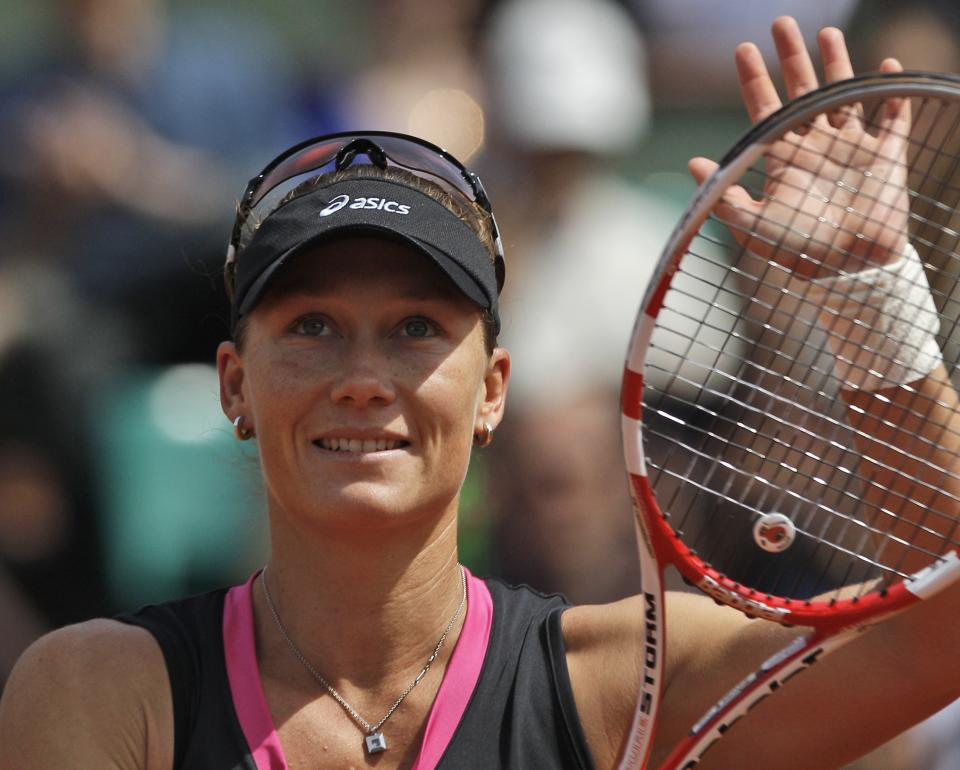 Australia's Samantha Stosur waves to the public after defeating Slovakia's Dominika Cibulkova during their quarterfinal match in the French Open tennis tournament at the Roland Garros stadium in Paris, Tuesday, June 5, 2012. Stosur won 6-4, 6-1. (AP Photo/Michel Spingler)