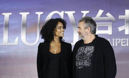 "French director Besson and his wife and producer Silla smile at each other during a news conference for his movie ""Lucy"" in Taipei"
