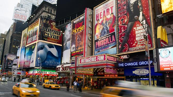 FILE - This Jan. 19, 2012 file photo shows billboards advertising Broadway shows in Times Square, in New York. The Broadway League announced, Monday, Oct. 29, that all performances will be canceled on Tuesday, Oct. 30, due to Hurricane Sandy.  (AP Photo/Charles Sykes, file)