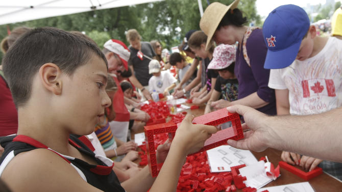 IMAGE DISTRIBUTED FOR LEGO SYSTEMS, INC - Dylan Turpan busy building at Canada Day LEGO Flag Build, on Monday July 1, 2013 at Parc Jacques-Cartier Park in Gatineau, Quebec. For Canada Day, children could help build a Canadian flag made out of 128,000 LEGO bricks (Francis Vachon / AP Images for LEGO Systems, Inc.)