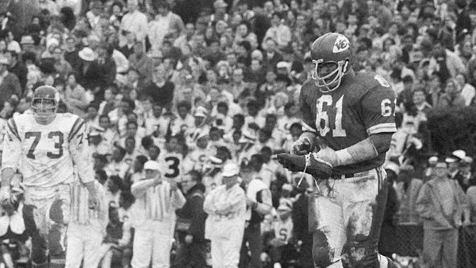 FILE - In t his Jan. 11, 1970, file photo, Kansas City defensive tackle Curley Culp heads towards the sidelines after losing a shoe during NFL football's Super Bowl IV against the Minnesota Vikings in New Orleans. Culp was selected to the Pro Football Hall of Fame on Saturday, Feb. 2, 2013. (AP Photo/JS, File)