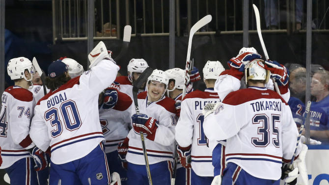 The Montreal Canadiens celebrate after defeating the New York Rangers 3-2 in overtime in Game 3 of the NHL hockey Stanley Cup playoffs Eastern Conference finals, Thursday, May 22, 2014, in New York. (AP Photo/Kathy Willens)