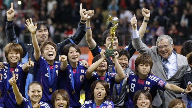 Japanese players celebrate with the trophy after winning the final match between Japan and the United States at the Women's Soccer World Cup in Frankfurt, Germany, Sunday, July 17, 2011. The Japanese women's soccer team won their first World Cup Sunday after defeating USA in a penalty shoot-out(AP Photo/Frank Augstein)