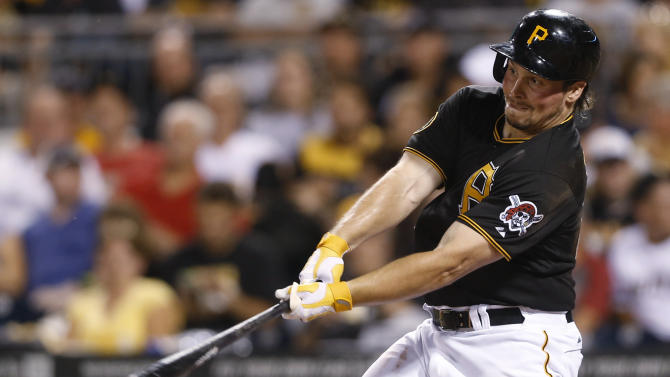 FILE - In this Aug. 18, 2014, file photo, Pittsburgh Pirates' Travis Snider hits a double against the Atlanta Braves during a baseball game in Pittsburgh. The Baltimore Orioles have acquired Snider from the Pirates for a minor league pitcher and a player to be named. The teams announced the trade Tuesday night, Jan. 27, 2015.. The Pirates got left-hander Stephen Tarpley. (AP Photo/Keith Srakocic, File)