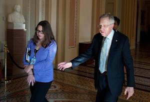 US Senate Majority Leader Harry Reid (R) walks through …