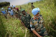 <p>Brigadier-General Harinder Singh, the United Nations brigade commander for North Kivu, is followed by General Lucien Bahuma (C), the new commander of the Armed Forces of the Democratic Republic of the Congo (FARDC) for North Kivu, following a strategy meeting above the village of Kibumba I, around 20km from the city of Goma in the Democratic Republic of the Congo.</p>