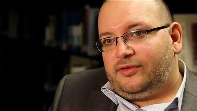 A November 6, 2013 photo provided by the Washington Post shows reporter Jason Rezaian at the newspaper's office in Washington