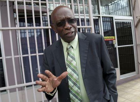 Trinidad and Tobago's former National Security Minister and former FIFA Vice President, Jack Warner, gestures after leaving the offices of the Sunshine Newspaper which he owns, in Arouca, East Trinidad