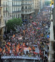 <p>A demonstration organized by unions takes place in Barcelona. Spanish police fired rubber bullets and charged protestors in central Madrid early Friday at the end of a huge demonstration against economic crisis measures.</p>