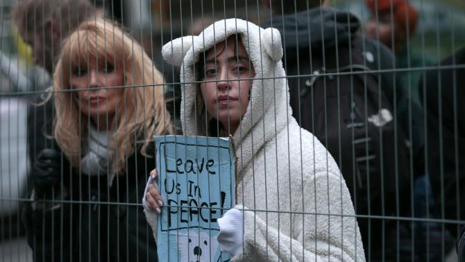 A protester wears a polar bear outfit during a rally held the day before the start of the Paris Climate Change Summit, in London