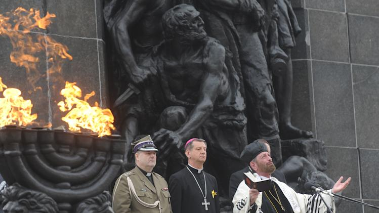 Cantor Joseph Malowany, right, sings during prayers in front of the Warsaw Ghetto Uprising memorial, during the revolt anniversary ceremonies in Warsaw, Poland, Friday, April 19, 2013. Sirens wailed and church bells tolled in Warsaw as largely Roman Catholic Poland paid homage Friday to the Jewish fighters who rose up 70 years ago against German Nazi forces in the Warsaw ghetto uprising. (AP Photo/Alik Keplicz)