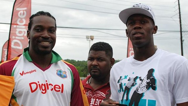 Olympic 100m champion and world record holder Usain Bolt(R) poses with West Indies' Chris Gayle (AFP)