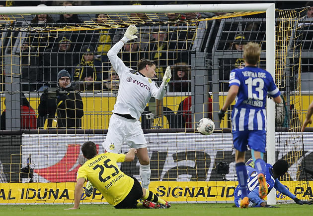 Berlin's Adrian Ramos of Colombia, down right, scores  during the German first division Bundesliga soccer match between Borussia Dortmund and Hertha BSC Berlin in Dortmund , Germany, Saturday, Dec