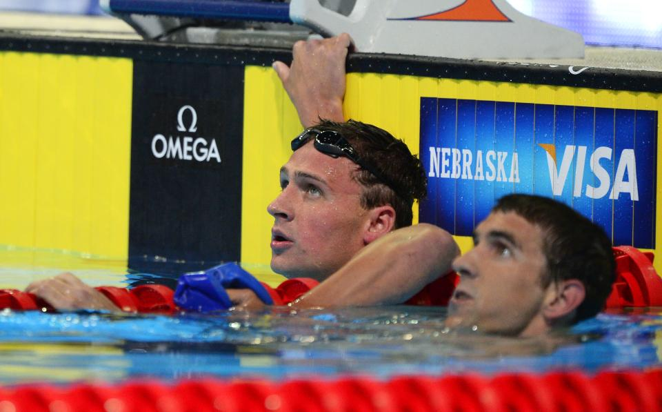 Ryan Lochte, left, and Michael Phelps watch the results in the men's 400-meter individual medley final at the U.S. Olympic swimming trials, Monday, June 25, 2012, in Omaha, Neb.  Lochte won the race. (AP Photo/Mark J. Terrill)