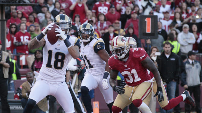 St. Louis Rams wide receiver Austin Pettis (18) scores a touchdown on a two-yard reception as San Francisco 49ers strong safety Donte Whitner (31) looks on during the fourth quarter of an NFL football game in San Francisco, Sunday, Nov. 11, 2012. (AP Photo/Jeff Chiu)