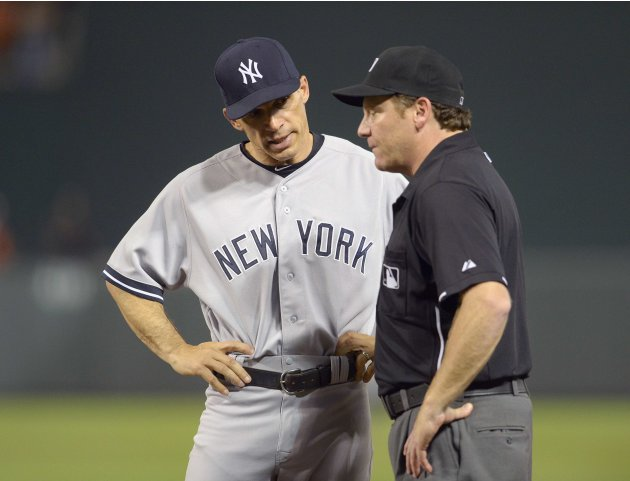 Yankees manager Girardi argues with first base umpire Schrieber after a disputed safe call on Baltimore Orioles batter Navarro, during their MLB American League baseball game in Baltimore