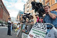 &lt;p&gt;Media wait outside the Ecuadorian Embassy in London on August 17, 2012. As fewer than ten police officers and a handful of Assange supporters stood outside the embassy Saturday, a police spokesman said officers would act &quot;in an appropriate manner&quot; if faced with an appearance by Assange.&lt;/p&gt;