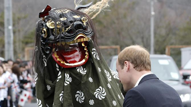 Britain's Prince William watches a local lion dance as he arrives at Chime of Hope shopping center in a neighborhood destroyed by the March 11, 2011 earthquake and tsunami, in Onagawa, Miyagi Prefecture, in northeastern Japan, Sunday, March 1, 2015. (AP Photo/Shizuo Kambayashi)
