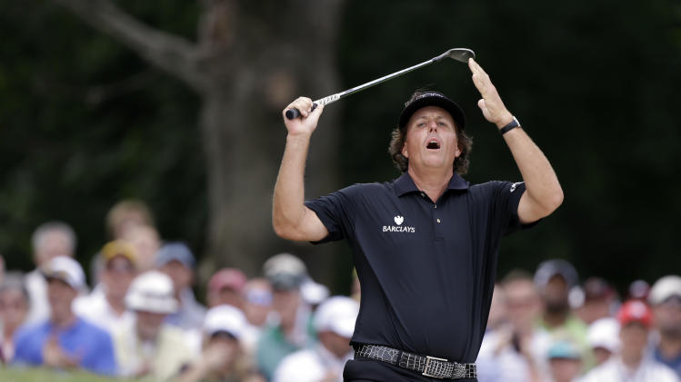 Phil Mickelson reacts to his shot from the bunker on the second hole during the fourth round of the U.S. Open golf tournament at Merion Golf Club, Sunday, June 16, 2013, in Ardmore, Pa. (AP Photo/Darron Cummings)