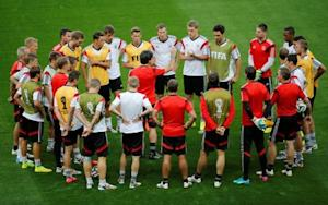 Germany's national soccer team coach Loew talks to his players during a training session in Belo Horizonte
