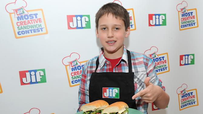 Jacob C., age 9 from Morganton, NC, was named the Grand Prize Winner of the 11th Annual Jif Most Creative Sandwich Contest on Thursday, March 21, 2013 at an event in New York City. He was presented with a $25,000 college fund for his winning recipe, the Magnificent Mole Chicken Torta.(Photo by Diane Bondareff/Invision for The J.M. Smucker Company/AP Images)