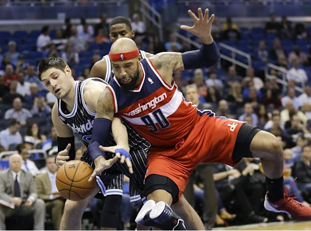 Orlando Magic's Nikola Vucevic, left, and Washington Wizards' Drew Gooden (90) go after a loose ball during the first half of an NBA basketball game in Orlando, Fla., Friday, March 14, 2014