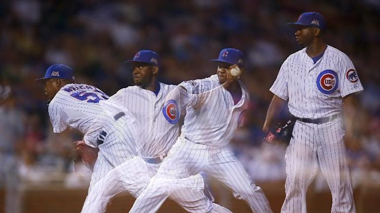 In this multiple exposure photo Chicago Cubs relief pitcher Wesley Wright (53) delivers a pitch against the San Diego Padres during the ninth inning of a baseball game in Chicago, Tuesday, July 22, 2014. The Cubs won the game 6-0. (AP Photo/Jeff Haynes)