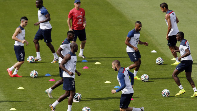 France's players run on the field during a training session at Santa Cruz stadium in Ribeirao Preto, Brazil, Saturday, June 28, 2014. France will face Nigeria on Monday in the round of 16 at the World Cup. (AP Photo/David Vincent)