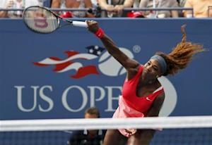Serena Williams of the U.S. serves to compatriot Stephens at the U.S. Open tennis championships in New York