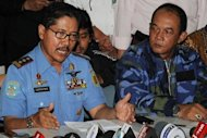 Indonesian National Search and Rescue Agency chief Vice Marshal Daryatmo (L) and Sukhoi representative Sunaryo at a press conference on the ill-fated Russian Sukhoi Superjet 100 that went missing