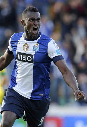 FC Porto's Jackson Martinez, from Colombia, celebrates after scoring his team second goal against Pacos Ferreira in the last match of the Portuguese League soccer season at Mata Real stadium in Pacos 