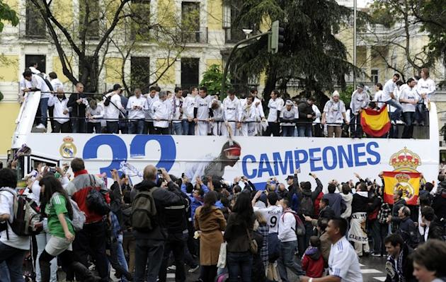 Real Madrid's Players Celebrate On An Open Bus Surrounded By Supporters At Cibeles Square In Madrid On May 3, 2012, A AFP/Getty Images