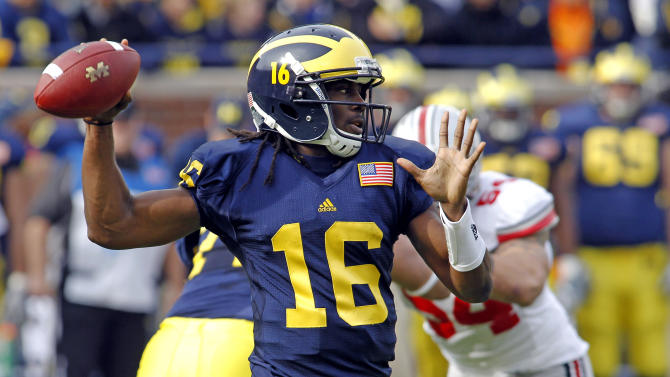 Michigan quarterback Denard Robinson (16) throws a pass in the first quarter of an NCAA college football game against Ohio State, Saturday, Nov. 26, 2011, in Ann Arbor, Mich. (AP Photo/Tony Ding)